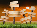 Wooden sign on the lawn with sunset Royalty Free Stock Photo