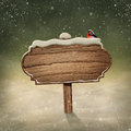 Wooden sign in snow and bird Royalty Free Stock Photography