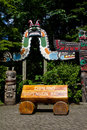 A wooden signboard at the Capilano Suspension Bridge in Vancouver, Canada Royalty Free Stock Photo