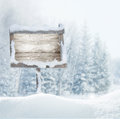 Wooden signboard in snow .Christmas banner. Royalty Free Stock Photo
