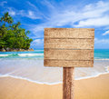 Wooden signboard on tropical beach Royalty Free Stock Photos
