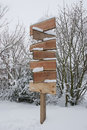 Wooden Signpost With Snow In Winter Stock Images