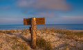 Wooden signpost standing in the dunes Royalty Free Stock Image