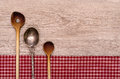 Wooden and silver spoon with text space on a board Stock Images