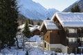 Wooden ski chalet in snow, mountain view