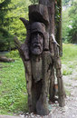 Wooden slavic idol in the forest Stock Photography