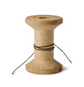 Wooden spool old with leftover threads isolated on white Royalty Free Stock Photography