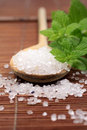 Wooden spoon with bath salt Royalty Free Stock Photo