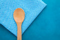Wooden spoon on blue checkered pattern cloth.jpg Royalty Free Stock Photo