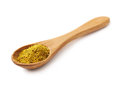 Wooden spoon of curry isolated Royalty Free Stock Photo