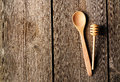 Wooden spoon and dipper on table Royalty Free Stock Photos