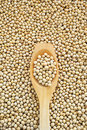 Wooden spoon and dried soybeans Royalty Free Stock Photo