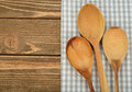 Wooden spoon and napkin on a brown background Royalty Free Stock Photo