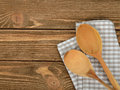 Wooden spoon and napkin on a brown background Royalty Free Stock Image