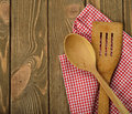 Wooden spoon and napkin on a brown background Stock Images