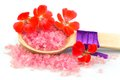 Wooden spoon with pink bath salt Royalty Free Stock Photo