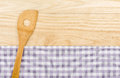 Wooden spoon on a purple checkered table cloth background Royalty Free Stock Photos