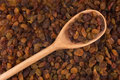 Wooden spoon with raisins Stock Image