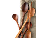 Wooden spoons on a kitchen towel isolated on white background Royalty Free Stock Photos