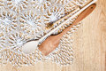 Wooden spoons on knitted lace tablecloth Royalty Free Stock Photo