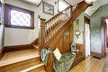 Wooden staircase with bench in old house Royalty Free Stock Photo