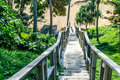 Wooden staircase down to the beautiful and relax sandy beach in phuket thailand Royalty Free Stock Image