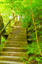 The wooden staircase in the mountains leads to top Stock Photo