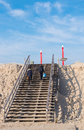 Wooden stairs couple climbing a over a sand dune on the nd maasvlakte in rotterdam this area opened in may means an expansion of Stock Image