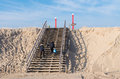 Wooden stairs couple climbing a over a sand dune on the nd maasvlakte in rotterdam this area opened in may means an expansion of Royalty Free Stock Photos