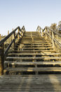 Wooden stairs on the dunes to access the beach.Guardamar del Seg Royalty Free Stock Photo