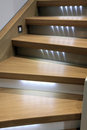 Wooden stairs with led backlight Stock Photos
