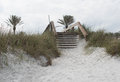 Wooden stairs over dunes at beach Royalty Free Stock Photo