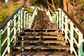 Wooden stairs of the park in sun light Royalty Free Stock Images