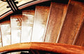 Wooden stairs part of an interior staircase in warm tones Stock Photo
