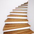 Wooden stairs and white wall leading up Stock Photo