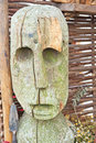 Wooden statue of celtic period reproduction carving head a man holding a spear from Royalty Free Stock Photography