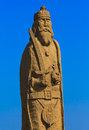 Wooden statue warior carved exposed on an open field Royalty Free Stock Photo