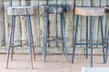 Wooden steel legs simplistic bar chair Royalty Free Stock Photo