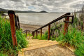 Wooden steps lead down to waters edge san francisco skyline background with richardson bay Stock Photo