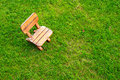 Wooden stool on green grass field Royalty Free Stock Photo