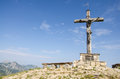 Wooden summit cross on the peak of neunerköpfle in tirol austria Royalty Free Stock Photography