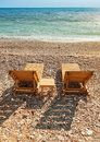 Wooden sun loungers on adriatic sea coast two stand the Stock Image