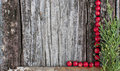 Wooden surface framed with berries a textured old and greenery Royalty Free Stock Photo