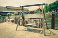 Wooden swing at antique market floating Stock Photo