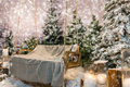 Wooden swing with a blanket and book on it in a snow-covered par Royalty Free Stock Photo