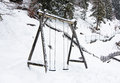 Wooden swing in the winter in mountains Stock Photography