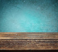 Wooden table against blue textured background retro Royalty Free Stock Image