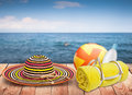 Wooden table with beach items blur sea on background template design Royalty Free Stock Image