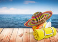 Wooden table with beach items blur sea on background template design Stock Photography