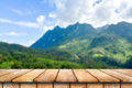 Wooden table on the beautiful mountain scenery. Royalty Free Stock Photo